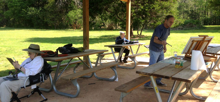 Louise Nerys And Fred Painting Outside Under A Pavilion